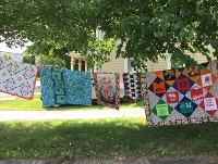 CT Quilts Hanging Outside